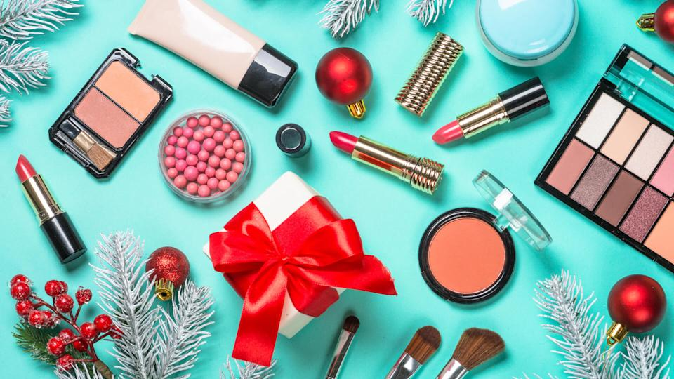 Christmas flat lay background with Makeup product, professional cosmetics on mint.