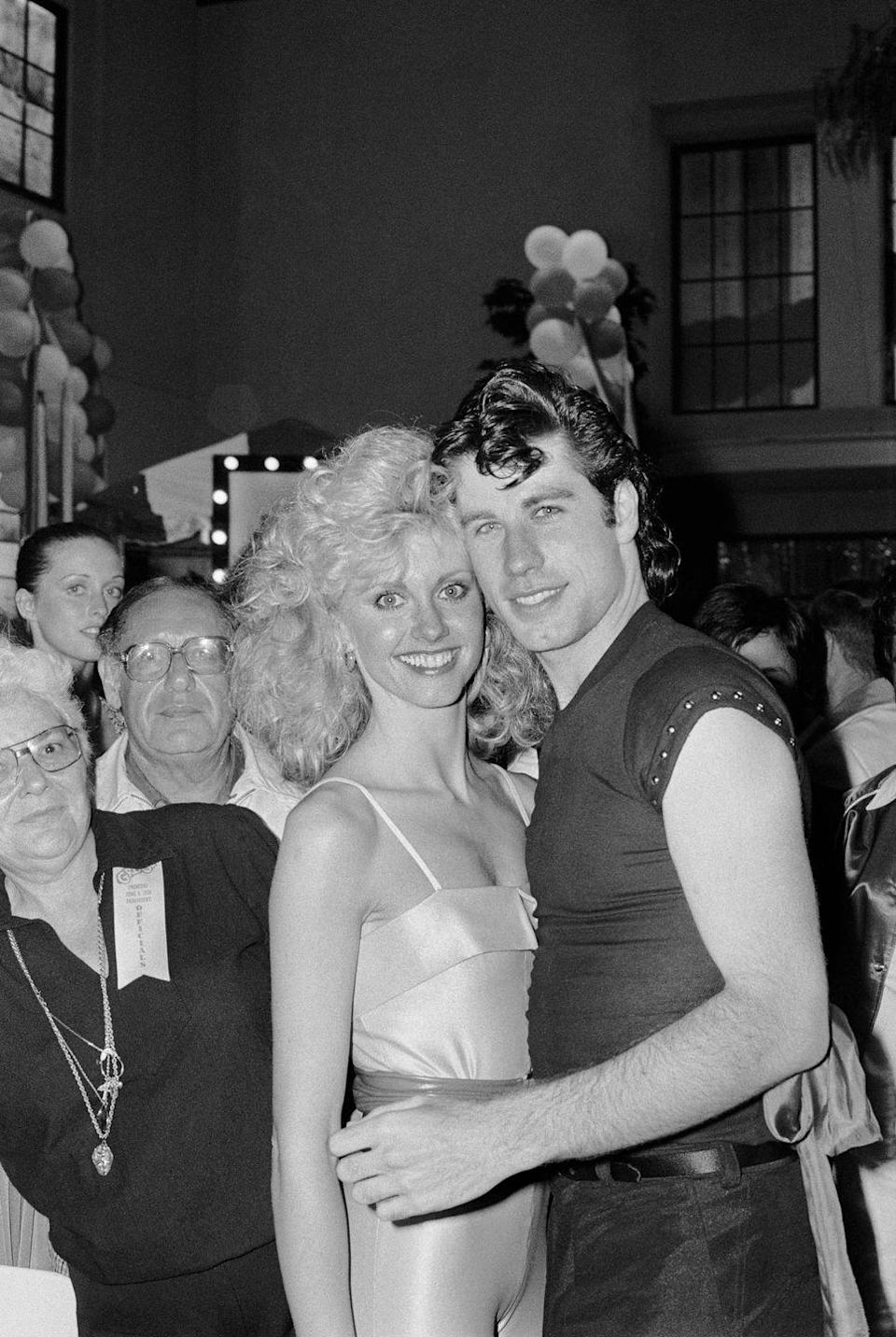 <p>John Travolta and Olivia Newton John attend a party following the gala premiere of their new movie, <em>Grease</em> in 1978.</p>