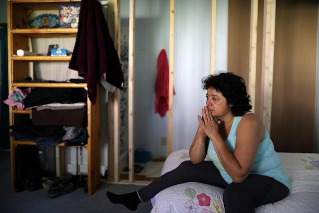 <p>Immigrant Rosa Sabido, 53, cries as she sits on her bed in the United Methodist Church in which she lives while facing deportation in Mancos, Colo., July 19, 2017. (Photo: Lucy Nicholson/Reuters) </p>