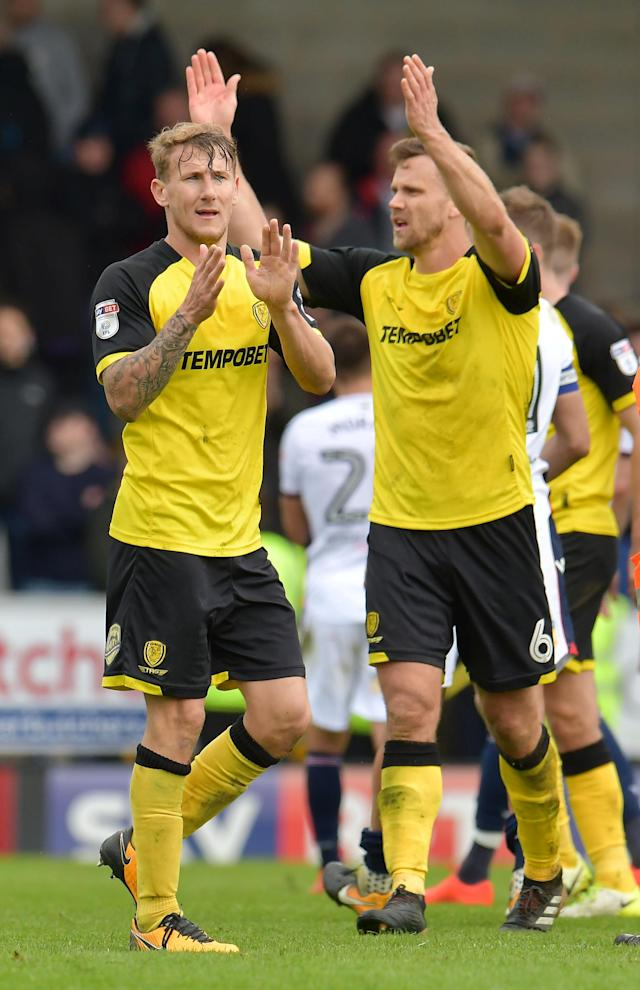 "Soccer Football - Championship - Burton Albion vs Bolton Wanderers - Pirelli Stadium, Burton, Britain - April 28, 2018 Burton Albion's Kyle McFadzean and Ben Turner celebrate after the match Action Images/Paul Burrows EDITORIAL USE ONLY. No use with unauthorized audio, video, data, fixture lists, club/league logos or ""live"" services. Online in-match use limited to 75 images, no video emulation. No use in betting, games or single club/league/player publications. Please contact your account representative for further details."