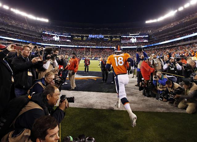 Denver Broncos' Peyton Manning runs to the field before the NFL Super Bowl XLVIII football game against the Seattle Seahawks, Sunday, Feb. 2, 2014, in East Rutherford, N.J. (AP Photo/Evan Vucci)