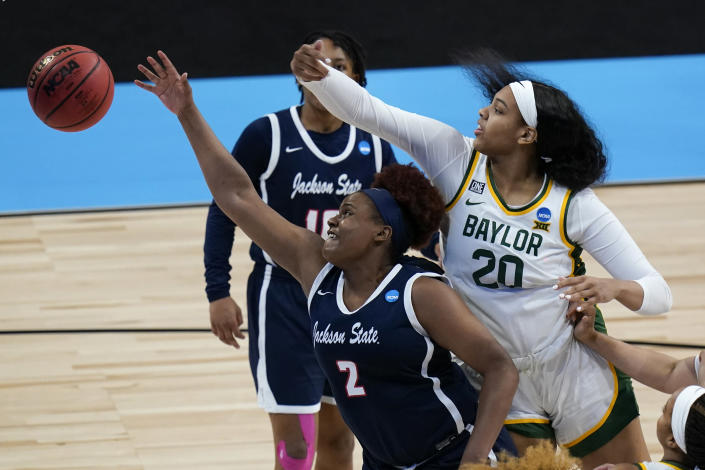 Jackson State center Antionette Womack (2) fights for a rebound with Baylor center Hannah Gusters (20) during the second half of a college basketball game in the first round of the women's NCAA tournament at the Alamodome, Sunday, March 21, 2021, in San Antonio. (AP Photo/Eric Gay)