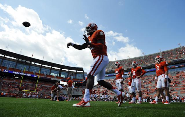Clemson quarterback Tajh Boyd (10) throws as he warms up before an NCAA college football game against Wake Forest, Saturday, Sept. 28, 2013, in Clemson, S.C. (AP Photo/Rainier Ehrhardt)