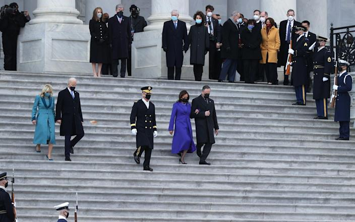Joe Biden, Kamala Harris and their partners at the Pass in Review ceremony - GETTY IMAGES