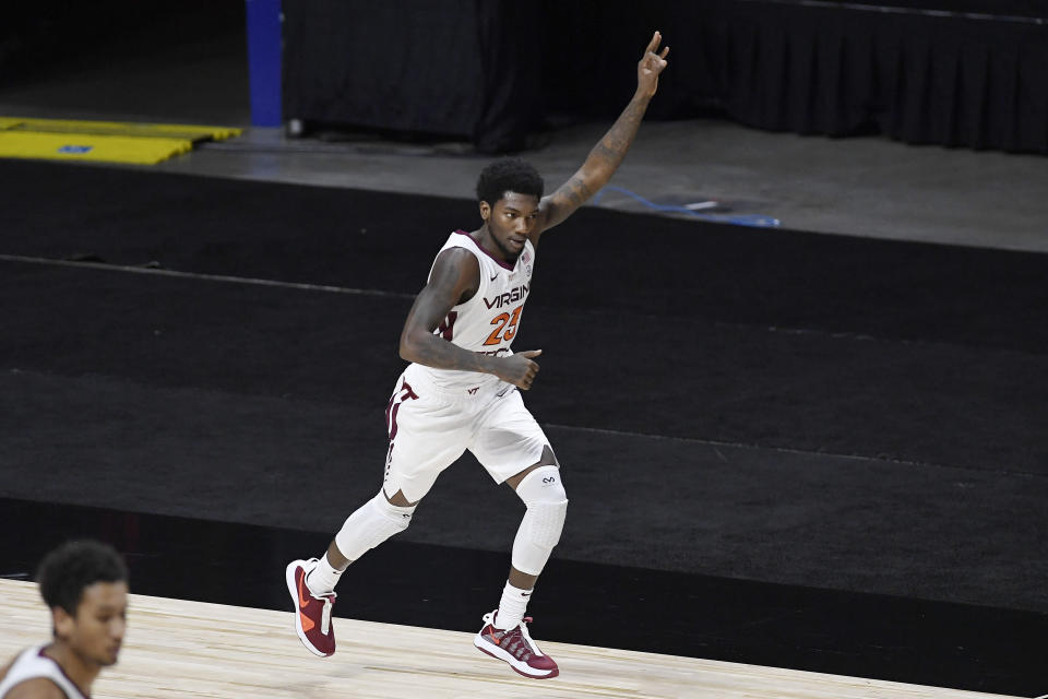 Virginia Tech's Tyrece Radford reacts after making a 3-point basket in the first half of an NCAA college basketball game against South Florida, Sunday, Nov. 29, 2020, in Uncasville, Conn. (AP Photo/Jessica Hill)