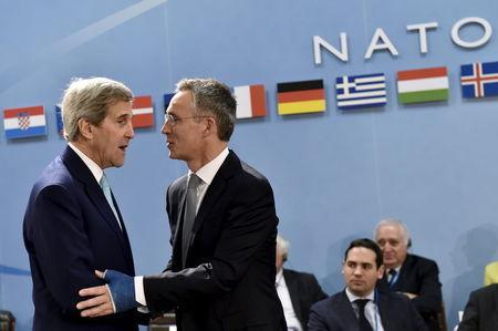 NATO Secretary-General Jens Stoltenberg welcomes U.S. Secretary of State John Kerry (L) during a NATO foreign ministers meeting at the Alliance headquarters in Brussels, Belgium, December 2, 2015. REUTERS/Eric Vidal