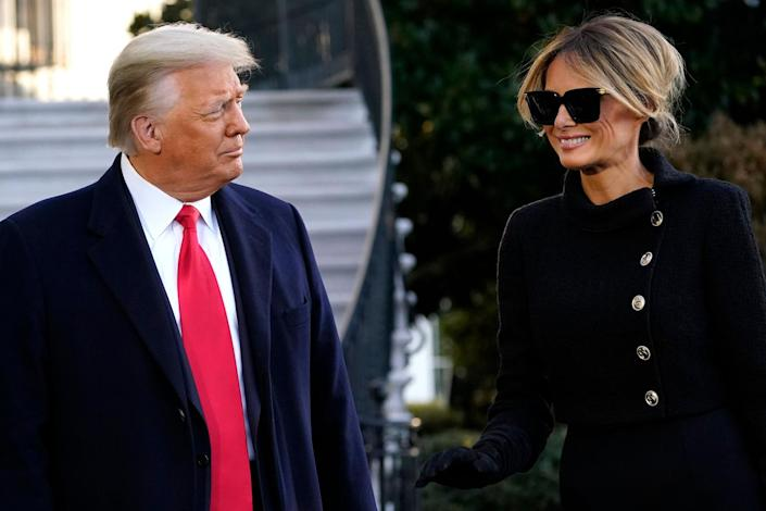 <p>Melania Trump smiles as she and her husband speak with reporters. </p>