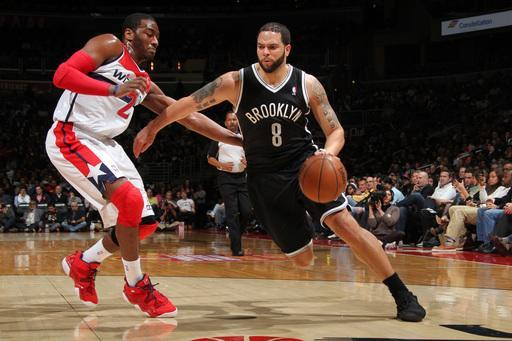 WASHINGTON, DC - FEBRUARY 8: Deron Williams #8 of the Brooklyn Nets drives against John Wall #2 of the Washington Wizards during the game at the Verizon Center on February 8, 2013 in Washington, DC. (Photo by Ned Dishman/NBAE via Getty Images)