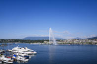 The fountain Jet d'eau in the Lake Geneva spray water, in Geneva, Switzerland Monday, June 14, 2021. The lakeside city known as a Cold War crossroads and a hub for Swiss discretion, neutrality and humanitarianism, is set to return to a spotlight on the world stage as U.S. President Joe Biden and Russian President Vladimir Putin come to town for a summit on Wednesday, June 16. (AP Photo/Markus Schreiber)