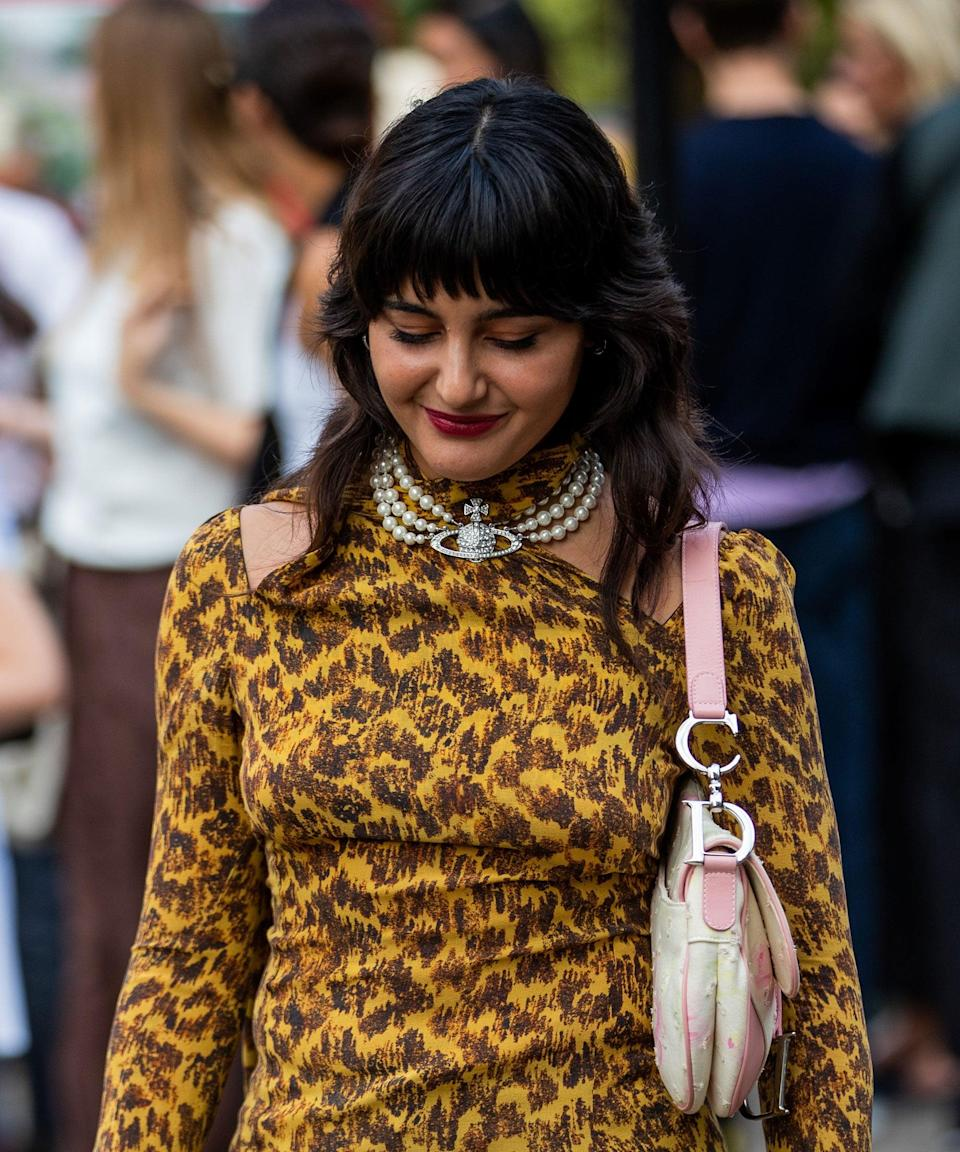 """Forget curtain bangs. This heavily layered <a href=""""https://www.refinery29.com/en-gb/spring-hair-trends-2021"""" rel=""""nofollow noopener"""" target=""""_blank"""" data-ylk=""""slk:shag cut"""" class=""""link rapid-noclick-resp"""">shag cut</a> looks incredible with a weighty, full fringe. <span class=""""copyright"""">Photo by Christian Vierig/Getty Images</span>"""