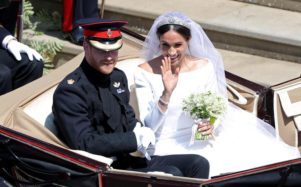 <p>Prince Harry, Duke of Sussex and Meghan, Duchess of Sussex leave Windsor Castle in the Ascot Landau carriage. Andrew Matthews – Pool/Getty Images </p>