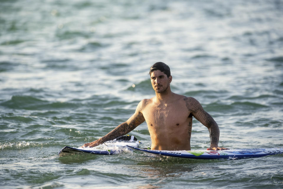 Surfer Gabriel Medina of Brazil comes out of the water after working out on a Surf Ranch wave during practice rounds for the upcoming Olympics Wednesday, June 16, 2021, in Lemoore, Calif. This year, Medina and fellow Brazilian Italo Ferreira are expected to rule the men's competition at surfing's long-awaited debut as an Olympic sport in the Tokyo 2020 Games. While the surfing community has long pledged that the ocean is for everyone, a look at the professional ranks show a sport that remains expensive and inaccessible. A series of recent industry efforts to help groom the next generation outside of the usual hot spots of Hawaii, California and Australia look to be a tacit acknowledgement of the existing disparities among its talent bench. (AP Photo/Noah Berger)