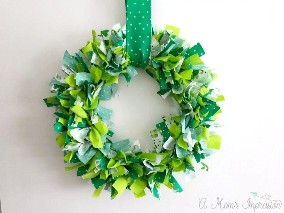 """<p>You only need a bit of green fabric and a wire frame to bring this wreath to life... because even your front door could use some holiday love.</p><p><strong>Get the tutorial at <a href=""""https://amomsimpression.com/how-to-make-a-shamrock-wreath/"""" rel=""""nofollow noopener"""" target=""""_blank"""" data-ylk=""""slk:A Mom's Impression"""" class=""""link rapid-noclick-resp"""">A Mom's Impression</a>. </strong></p><p><strong><a class=""""link rapid-noclick-resp"""" href=""""https://www.amazon.com/Michael-Miller-Dumb-Clover-Fabric/dp/B07MNVBXZM/?tag=syn-yahoo-20&ascsubtag=%5Bartid%7C10050.g.4035%5Bsrc%7Cyahoo-us"""" rel=""""nofollow noopener"""" target=""""_blank"""" data-ylk=""""slk:SHOP GREEN FABRIC"""">SHOP GREEN FABRIC</a><br></strong></p>"""