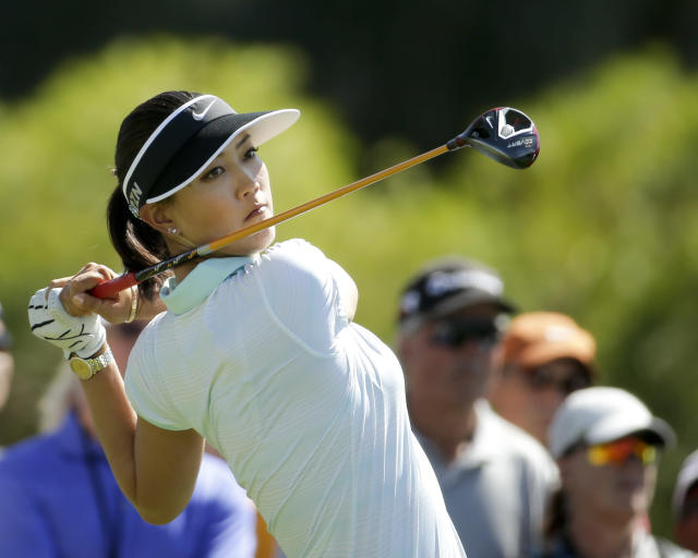 Michelle Wie watches her tee shot on the sixth hole during the final round of the Kraft Nabisco Championship golf tournament Sunday, April 6, 2014 in Rancho Mirage, Calif. (AP Photo/Chris Carlson)