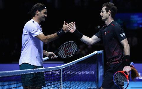 <span>Roger Federer and Murray meet at the net on Tuesday night</span>