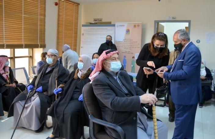 Jordanians wait to receive the COVID-19 vaccine, at a medical center in Amman
