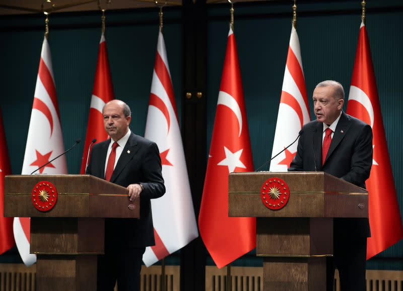 FILE PHOTO: Turkish President Erdogan and Turkish Cypriot leader Tatar attend a news conference in Ankara