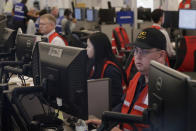Pacific Gas & Electric employees work in the PG&E Emergency Operations Center in San Francisco, Thursday, Oct. 10, 2019. More than 1.5 million people in Northern California were in the dark Thursday, most for a second day, after the state's biggest utility shut off electricity to many areas to prevent its equipment from sparking wildfires as strong winds sweep through. (AP Photo/Jeff Chiu)