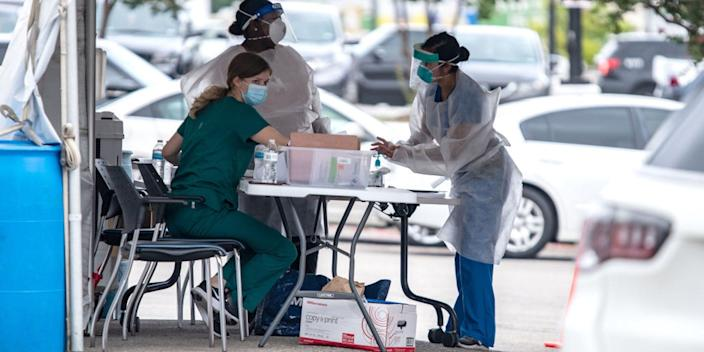 Medical personnel work at a COVID-19 testing center on July 7, 2020 in Austin, Texas.