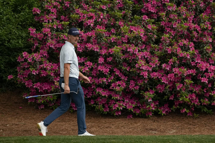 Justin Rose, of England, walks on the 12th hole during the first round of the Masters golf tournament on Thursday, April 8, 2021, in Augusta, Ga. (AP Photo/Charlie Riedel)