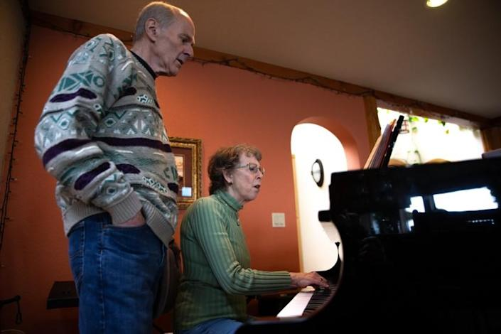 "Skagit Valley Chorale members Mark Backlund and his wife, Ruth Backlund, sing choir music Friday at their home in Anacortes, Wash., while convalescing from COVID-19. <span class=""copyright"">(Karen Ducey / For The Times)</span>"