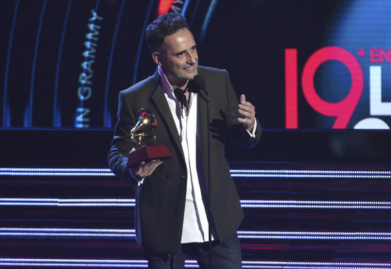 """Jorge Drexler accepts the award for song of the year for """"Telefonia"""" at the Latin Grammy Awards on Thursday, Nov. 15, 2018, at the MGM Grand Garden Arena in Las Vegas. (Photo by Chris Pizzello/Invision/AP)"""