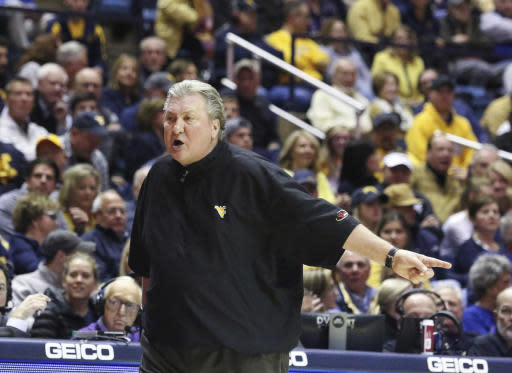 West Virginia head coach reacts during an NCAA college basketball game against Akron, Friday, Nov. 8, 2019, in Morgantown, W.Va. (AP Photo/Kathleen Batten)