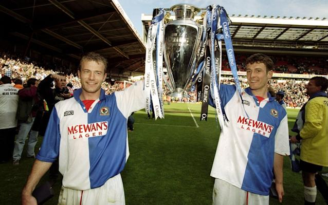 <span>Sutton (R) lifts the Premier League trophy with Blackburn in 1995</span> <span>Credit: Getty Images  </span>