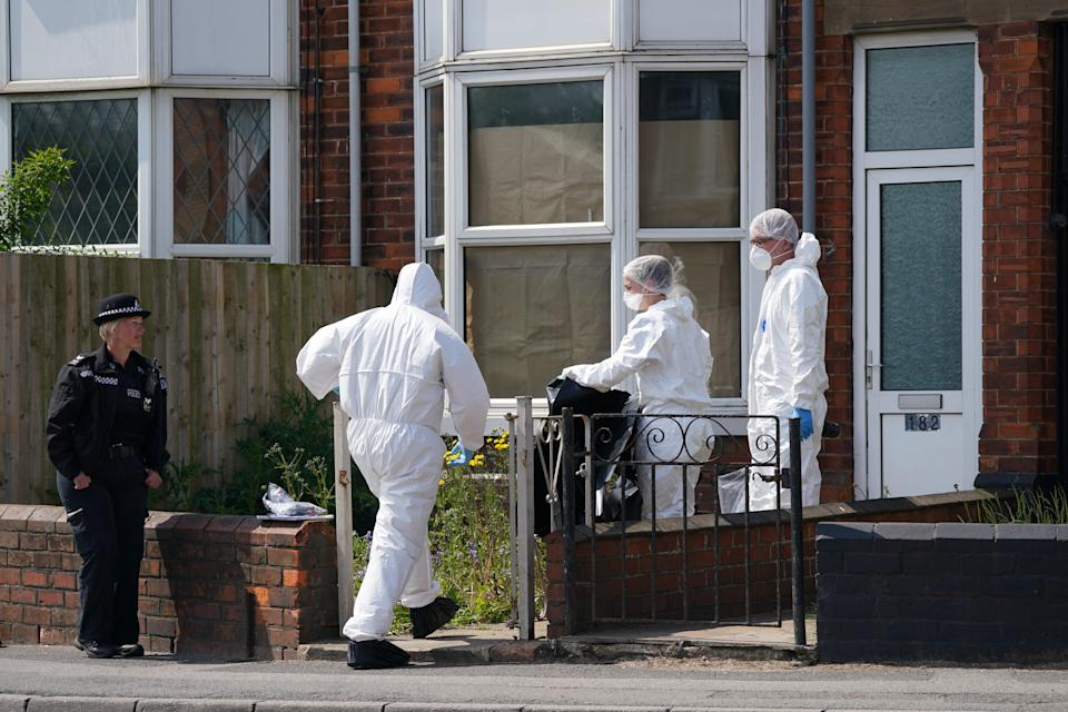 Forensic officers also appeared at the scene (PA Wire)