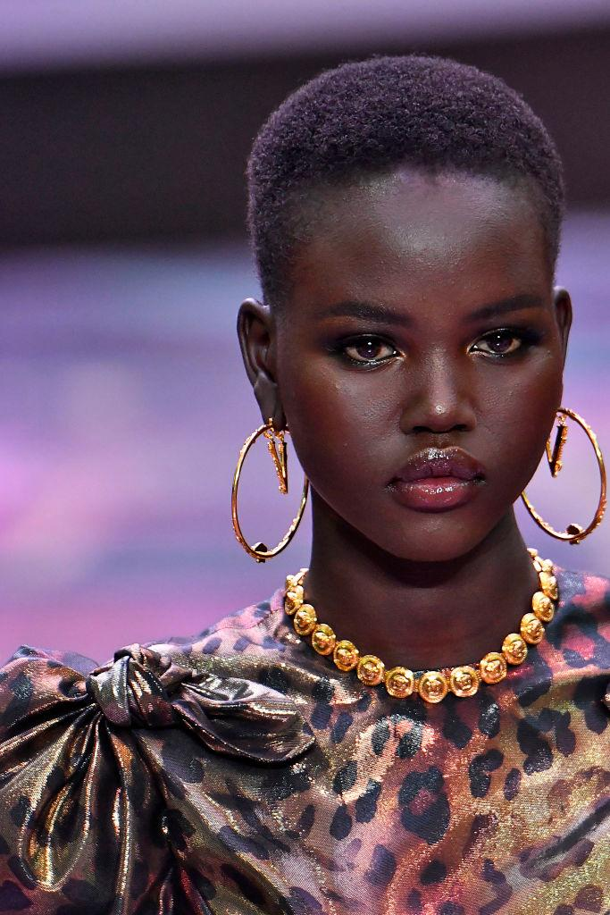 Adut Akech walks the runway at the Versace fashion in Milan this year [Photo: Getty]