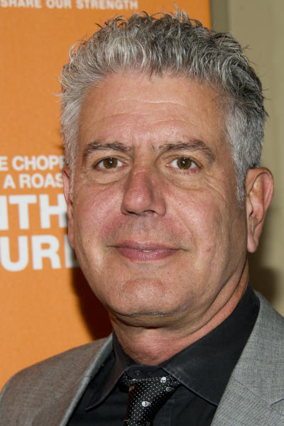 """FILE - In this Oct. 11, 2012 file photo, Anthony Bourdain attends """"On The Chopping Block: A Roast of Anthony Bourdain,"""" in New York. Bourdain's """"Parts Unknown"""" series, a culinary travelogue, swiftly became CNN's top-rated series since debuting last April, a bright spot at a place that was in a severe dry spell before the missing Malaysian plane kicked up ratings. A new eight-episode season begins Sunday, April 13, 2014, at 9 p.m. EDT. (Photo by Charles Sykes/Invision/AP, file)"""