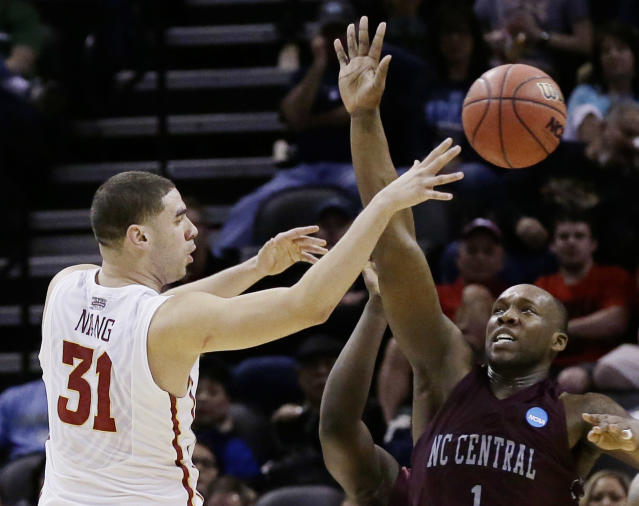 Iowa State forward Georges Niang (31) pass the ball as North Carolina Central forward Jay Copeland (1) defends during the first half of a second-round game in the NCAA college basketball tournament Friday, March 21, 2014, in San Antonio. (AP Photo/Eric Gay)