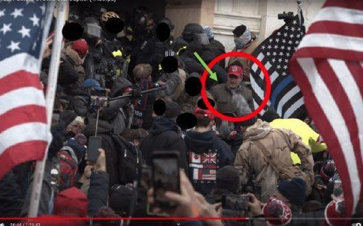 """Video footage alleges to show Mr Klein wearing a red """"Make America Great Again"""" cap and that he was """"resisting officers, attempting to take items from officers, and assaulting officers with a riot shield."""" - FBI"""