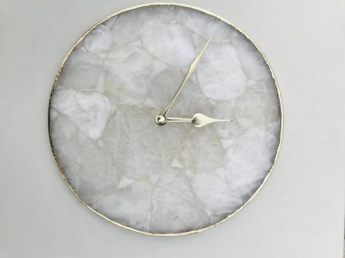 """This elegant clock with quartz movement is made of agate. It's surrounded by brass and features brass hands. You can customize it to have numbers, roman numerals, Arabic numerals, or text of any kind added. It measures 10 inches in diameter. $122, Etsy. <a href=""""https://www.etsy.com/listing/723732581/large-clear-crystal-agate-wall"""" rel=""""nofollow noopener"""" target=""""_blank"""" data-ylk=""""slk:Get it now!"""" class=""""link rapid-noclick-resp"""">Get it now!</a>"""