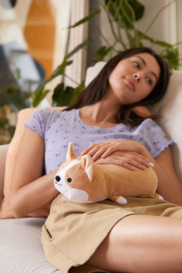 "<p>This <a href=""https://www.popsugar.com/buy/Smoko-Toasty-Heatable-Plushie-495049?p_name=Smoko%20Toasty%20Heatable%20Plushie&retailer=urbanoutfitters.com&pid=495049&price=29&evar1=savvy%3Auk&evar9=45407144&evar98=https%3A%2F%2Fwww.popsugar.com%2Fsmart-living%2Fphoto-gallery%2F45407144%2Fimage%2F46685293%2FSmoko-Toasty-Heatable-Plushie&list1=shopping%2Cgifts%2Choliday%2Cstocking%20stuffers%2Cgift%20guide%2Cinstagram%2Cgifts%20for%20women%2Cgifts%20for%20teens&prop13=api&pdata=1"" rel=""nofollow"" data-shoppable-link=""1"" target=""_blank"" class=""ga-track"" data-ga-category=""Related"" data-ga-label=""https://www.urbanoutfitters.com/shop/smoko-toasty-heatable-plushie?category=new-music-tech&amp;color=023&amp;quantity=1&amp;size=ONE%20SIZE&amp;type=REGULAR"" data-ga-action=""In-Line Links"">Smoko Toasty Heatable Plushie</a> ($29) will keep you comfortable, plus that corgi is insanely adorable.</p>"