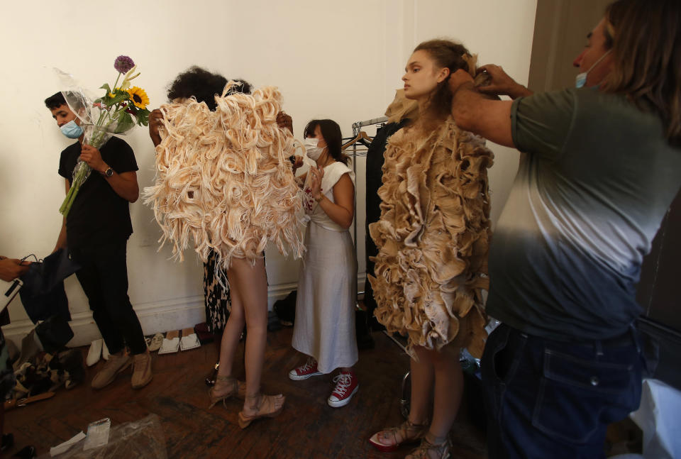 """Models wear creations part of the Claudia Gisele 2021 women's spring-summer collection at the """"We are Made in Italy - Black Lives Matter in Italian fashion Collection"""" event during the Milan's fashion week in Milan, Italy, Thursday, Sept. 17, 2020. (AP Photo/Antonio Calanni)"""