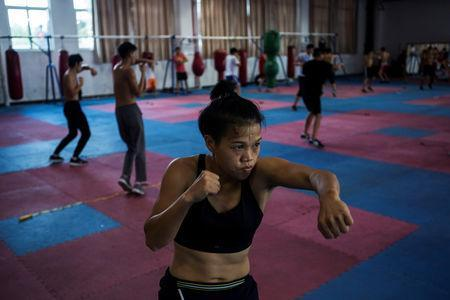 Huang Wensi in action during her final training session in Ningbo, Zhejiang province, China, before she heads to Taiwan for her Asia Female Continental Super Flyweight Championship match, September 22, 2018. REUTERS/Yue Wu
