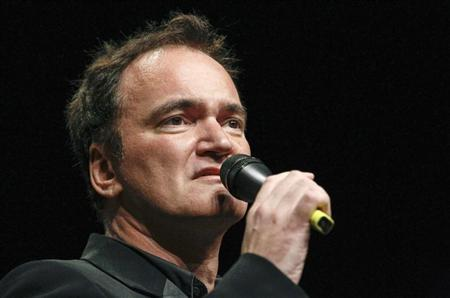 U.S. director Tarantino speaks before receiving the Prix Lumiere during a ceremony at the Lumiere 2013 Grand Lyon Film Festival in Lyon