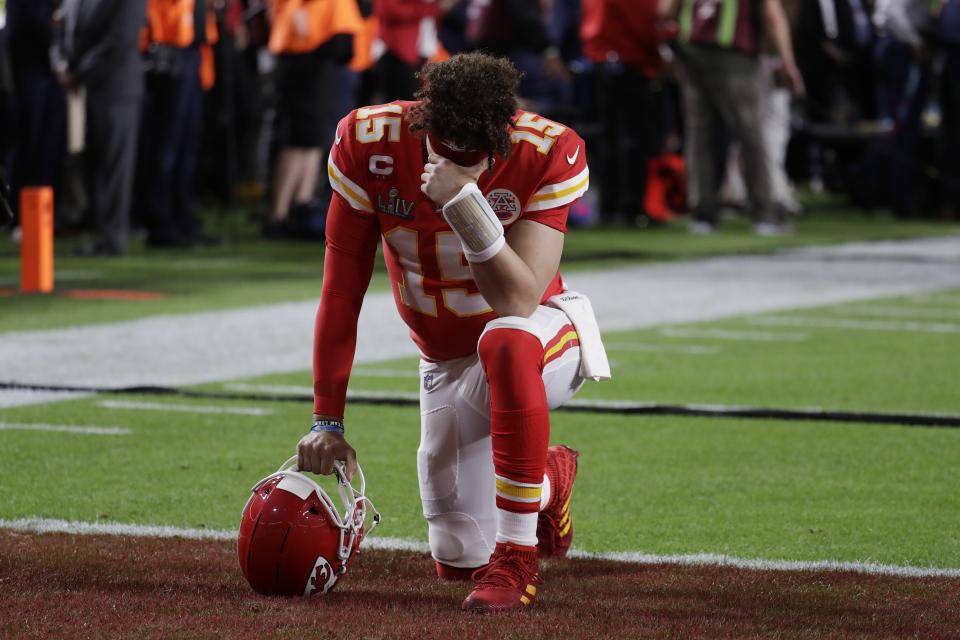 Kansas City Chiefs quarterback Patrick Mahomes takes a moment to reflect before the NFL Super Bowl 54 football game between the San Francisco 49ers and Kansas City Chiefs Sunday, Feb. 2, 2020, in Miami Gardens, Fla. (AP Photo/Lynne Sladky)