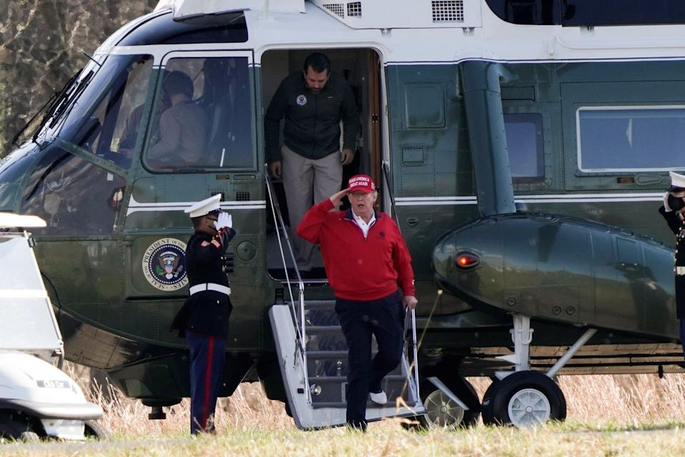 <p>Donald Trump gets off Marine One with son Donald Trump Jr for a round of golf in Sterling, Virginia</p> (REUTERS)