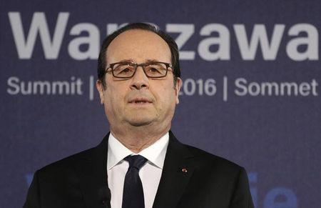 French President Hollande speaks during a news conference at the NATO Summit in Warsaw