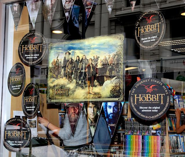 "Shop windows advertising the ""The Hobbit"" book and movie in the central business district in Wellington, New Zealand in 2012. (Credit: Marty Melville/AFP via Getty Images)"