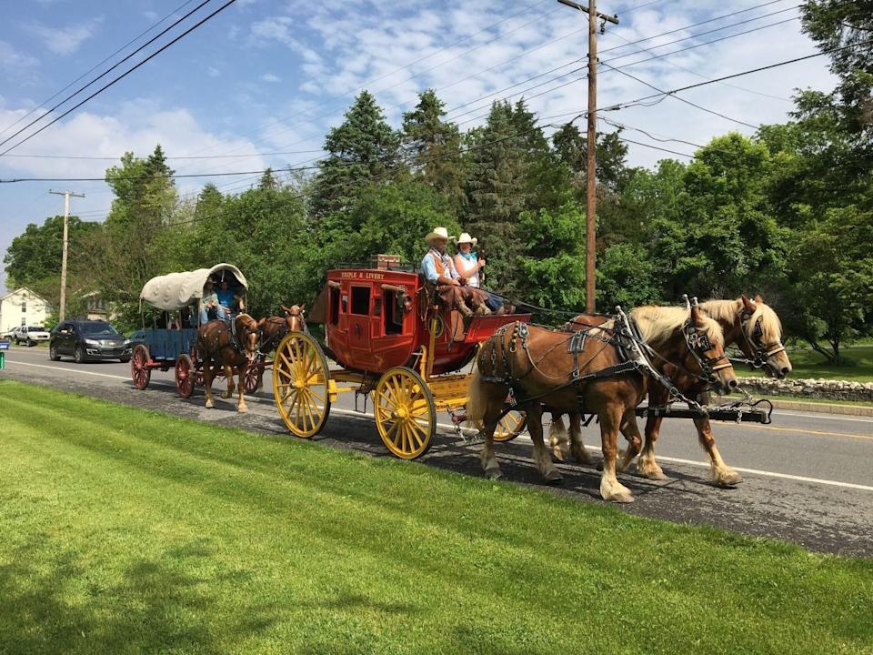 The James Shaull Wagon Train makes its way east on U.S. 40, near Spickler Road east of Clear Spring, on May 18, 2019.