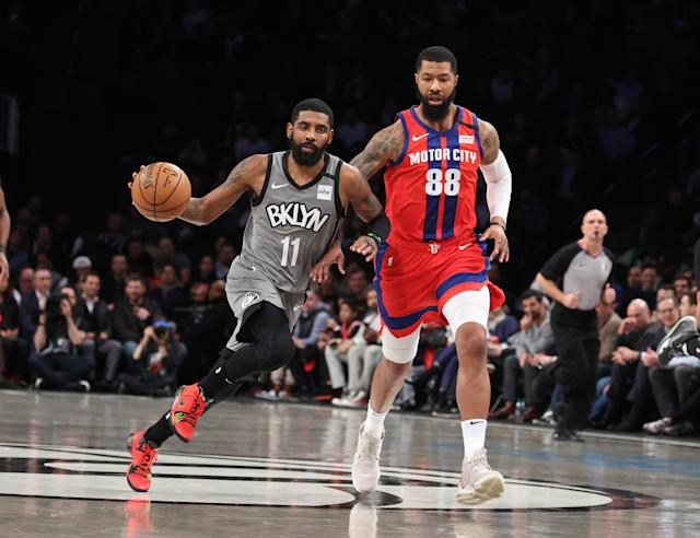 The Nets' Kyrie Irving dribbles past the Pistons' Markieff Morris on Wednesday night in New York. (Photo by Al Bello/Getty Images)