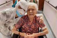 """In this photo taken on April 1, 2020, 103-year-old Ada Zanusso, poses with a nurse at the old people's home """"Maria Grazia"""" in Lessona, northern Italy, after recovering from Covid-19 infection. To recover from coronavirus infection, as she did, Zanusso recommends courage and faith, the same qualities that have served her well in her nearly 104 years on Earth. The new coronavirus causes mild or moderate symptoms for most people, but for some, especially older adults and people with existing health problems, it can cause more severe illness or death. (Residenza Maria Grazia Lessona via AP Photo)"""