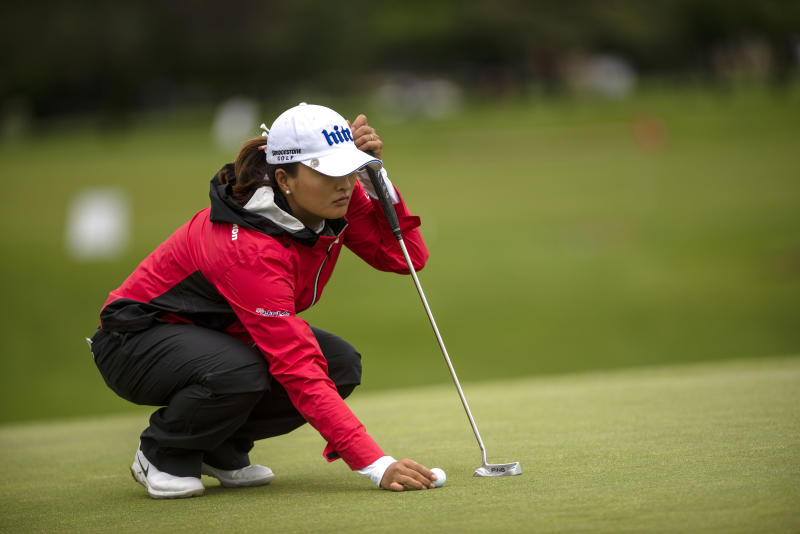 Jin Young Ko, of South Korea, lines up her putt on the first hole, during the first round of the Meijer LPGA Classic golf tournament at Blythefield Country Club on Thursday, June 13, 2019, in Belmont, Mich. (Alyssa Keown/The Grand Rapids Press via AP)