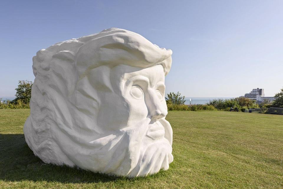 """<p>""""Pilar Quinteros' Janus Fortress: Folkestone is placed high up on the East Cliff where this vast two-faced sculptural head overlooks both the town and France, worth a visit for the site alone. But its poignancy and topicality come from its materials – our realisation that it is made from chalk and, like the cliffs of fortress Britain, is disintegrating even as we look at it.""""</p>"""