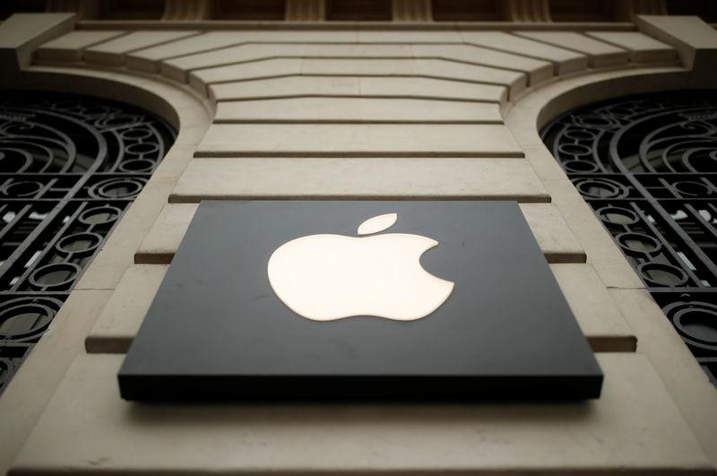 FILE PHOTO: The logo of Apple company is seen outside an Apple store in Paris, France, April 10, 2019. REUTERS/Christian Hartmann