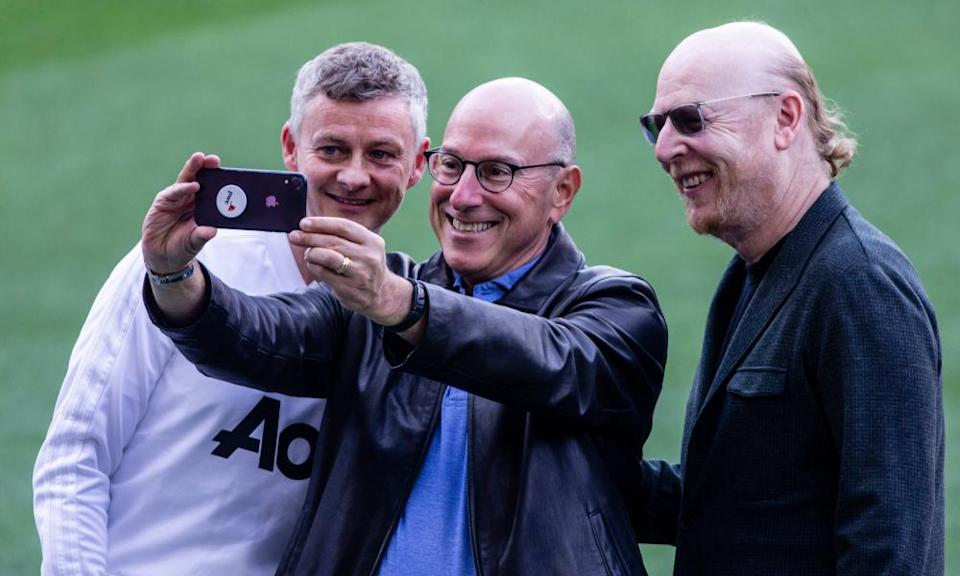 Manchester United's Joel Glazer with his brother Avram and Ole Gunnar Solskjær