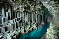 """<p>This Scottish sea cave is made up of hexagonally jointed basalt columns created by intense volcanic activity. It's Gaelic name means """"the melodious cave"""" due to its haunting cathedral-like atmosphere. Creepy.</p>"""